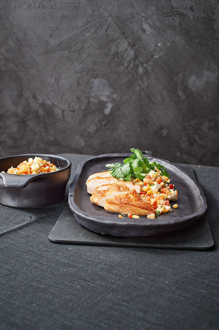 Colourful lentil salad with chicken breast strips