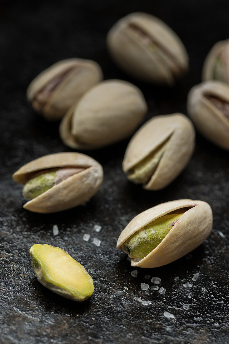 Salted pistachio nuts in shells (close-up)