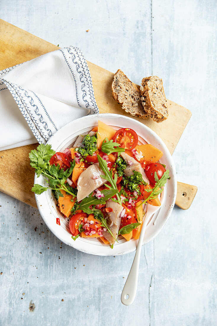 Soused herring salad with papaya