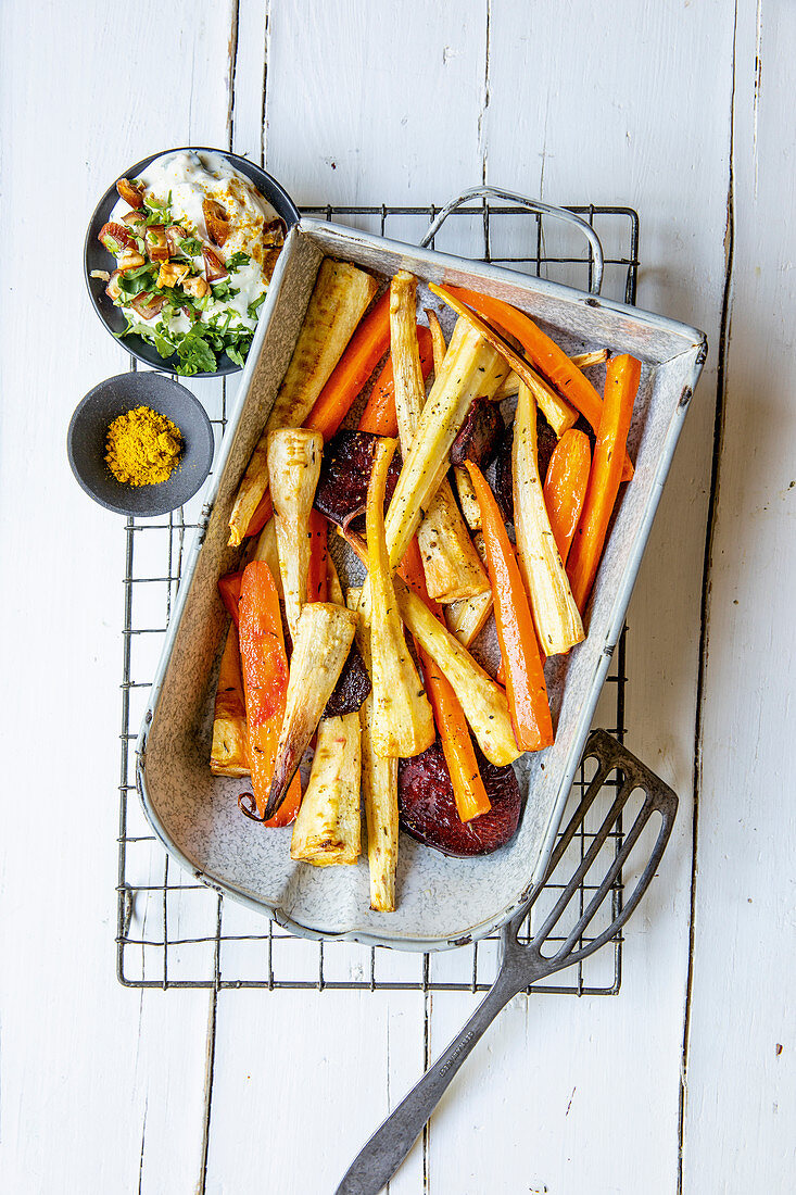 Oven-roasted root vegetables with a date and walnut dip