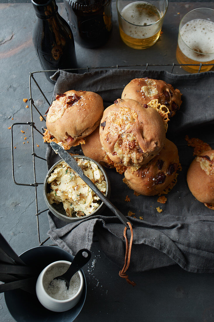 Beer rolls with bacon, alpine cheese and onion and garlic butter
