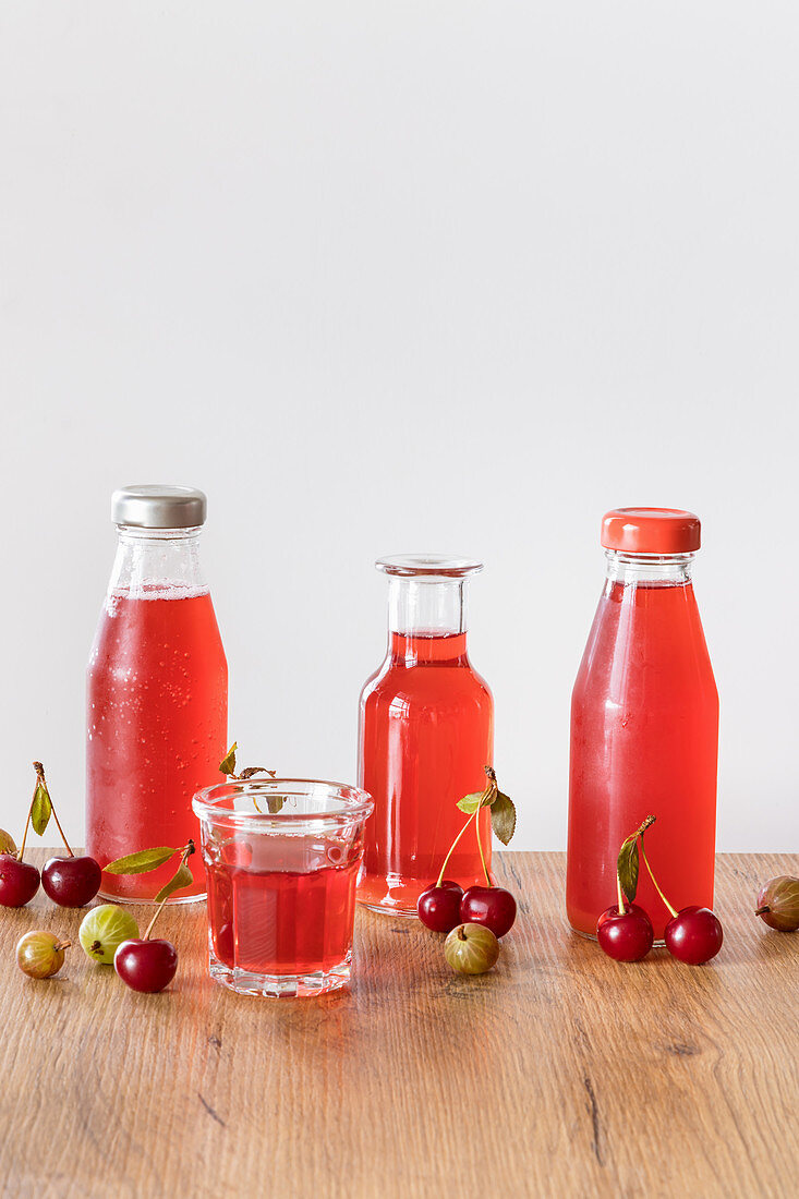 Fruit drink made with stewed cherries and gooseberries