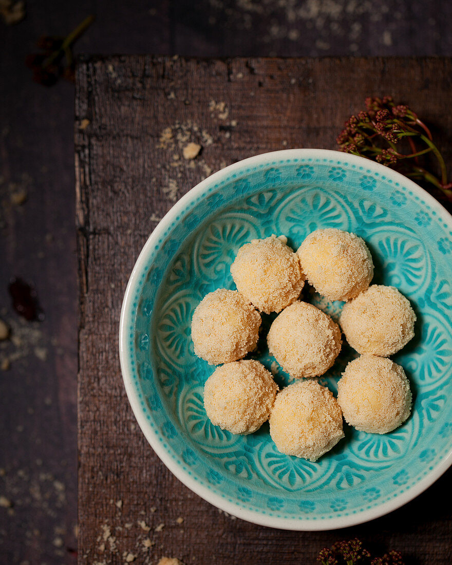 White chocolate truffles in a blue bowl