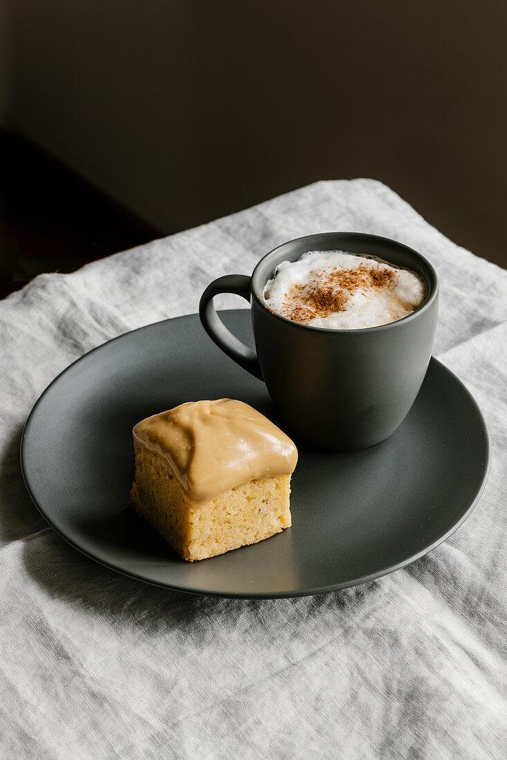 Caramelized chocolate mini pound cake and coffe cappuccino