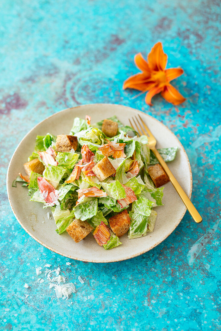 Caesar salad with lilies, wholemeal croutons and Parmesan cheese