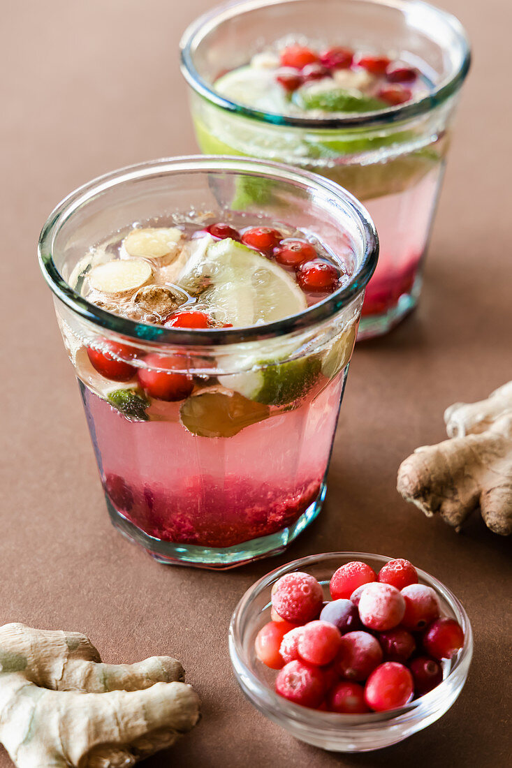 Ginger and cranberry drinks with honey and lime