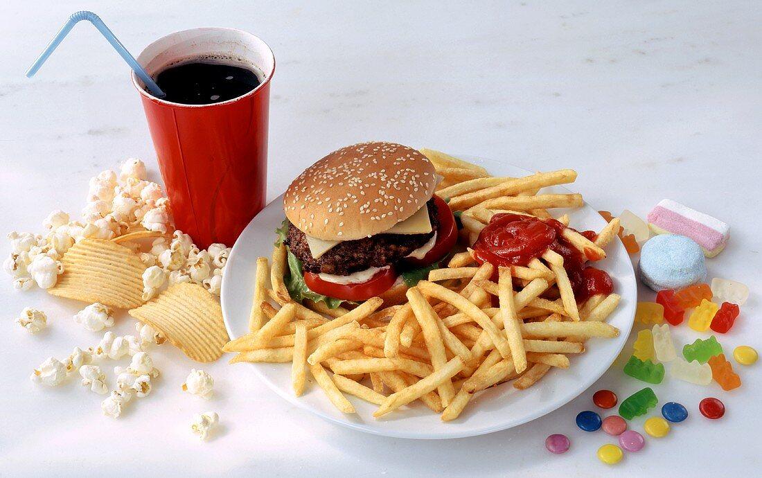 Fast food menu: hamburger with chips, cola, popcorn, nibbles