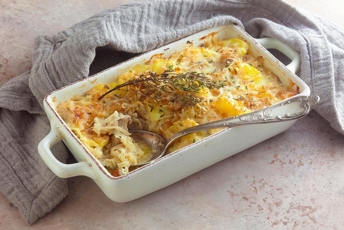 Sauerkraut and potato bake with sausages