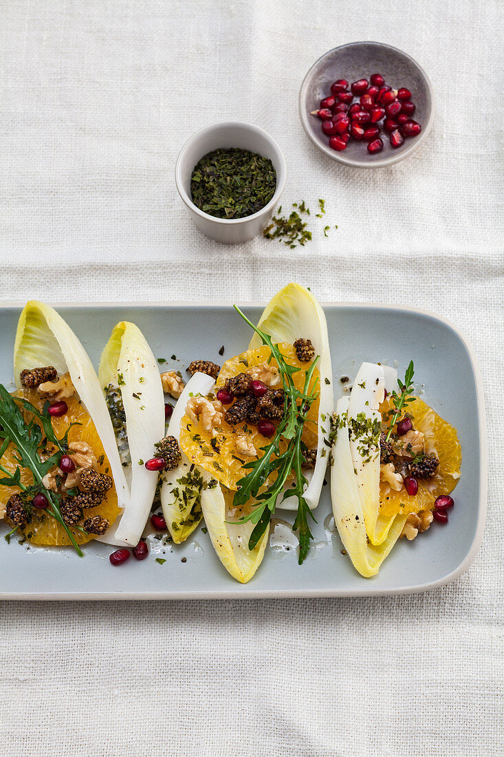 Chicory and orange salad with pomegranate seed and ulva flakes