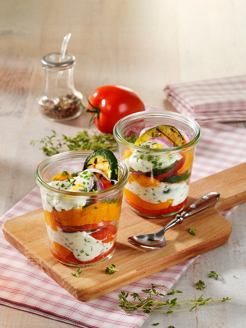 Grilled vegetables with goat's cheese served in glasses