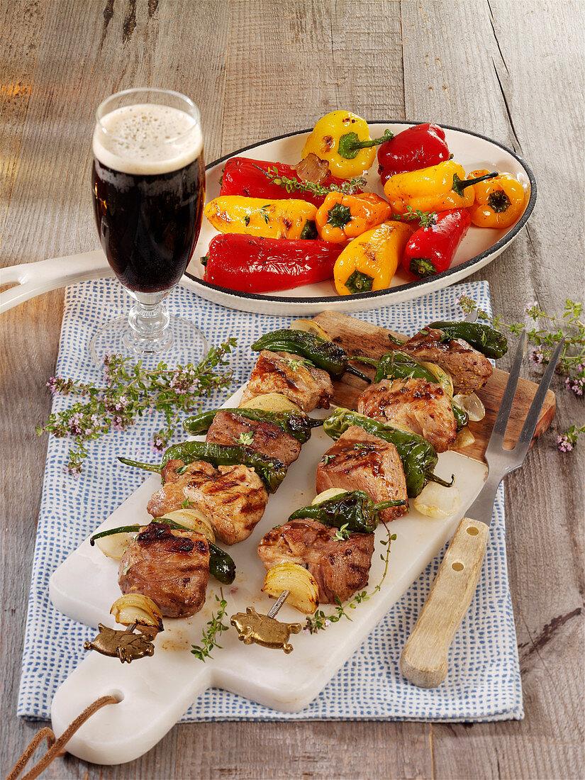 Grilled black beer pork collar skewers with pimientos