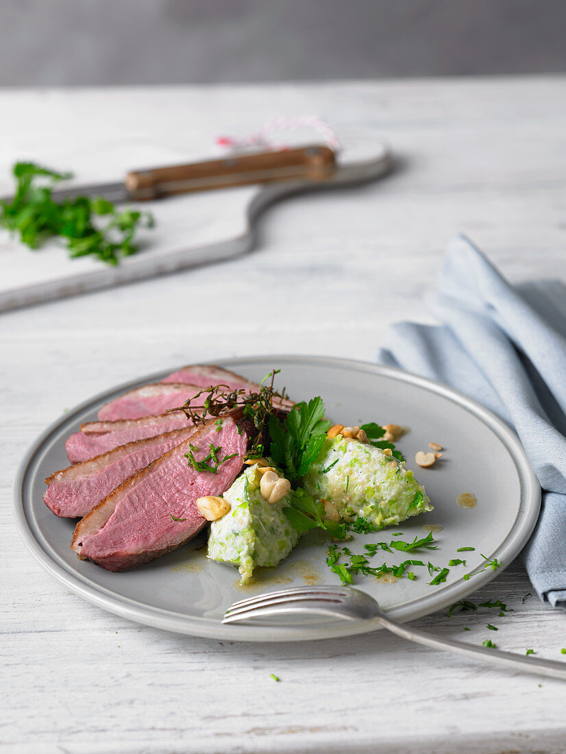 Duck breast with cabbage and cashew dumplings
