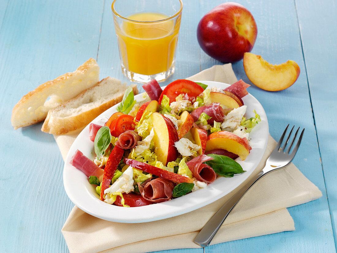 Nectarine and mozzarella salad with Parma ham rolls