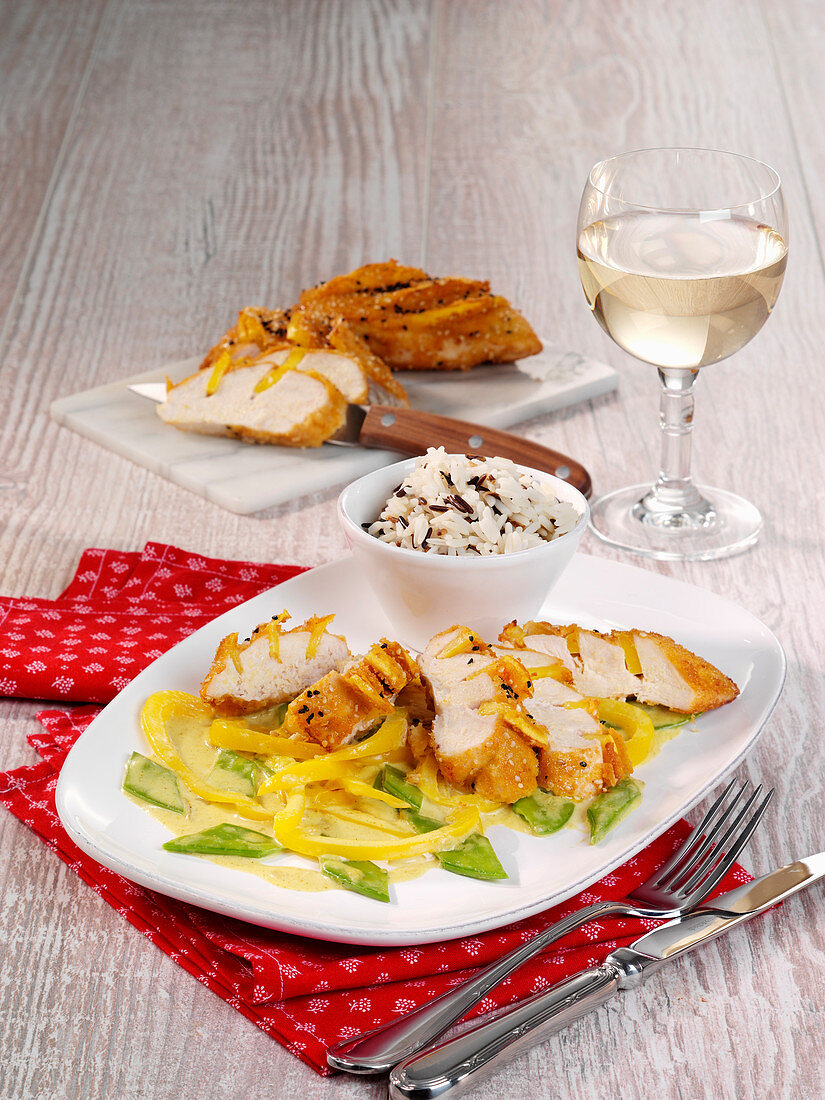 Chicken and mango escalopes with sesame seeds