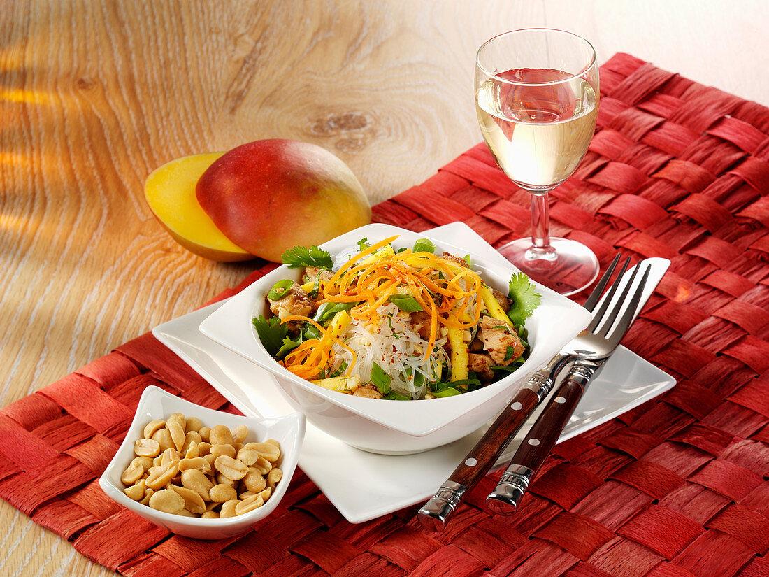 Oriental pasta salad with chicken, mango and chilli