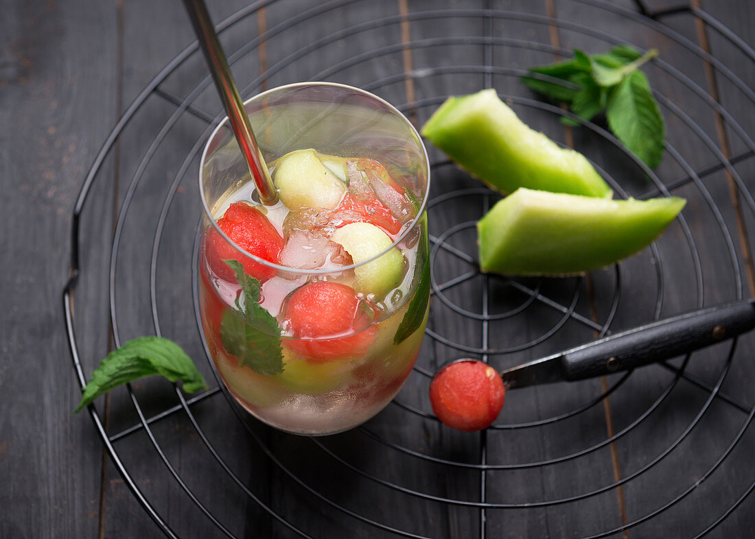 Fizzy white wine Sangria with watermelon and melon balls