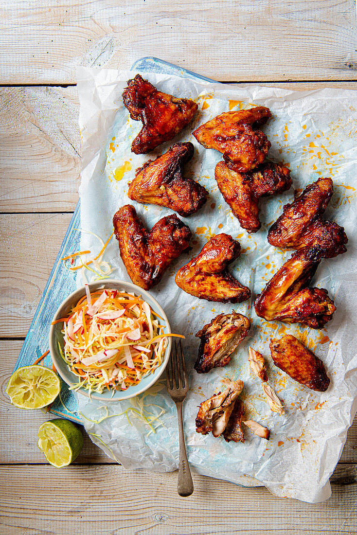 BBQ chicken wings with cabagge and lime slaw
