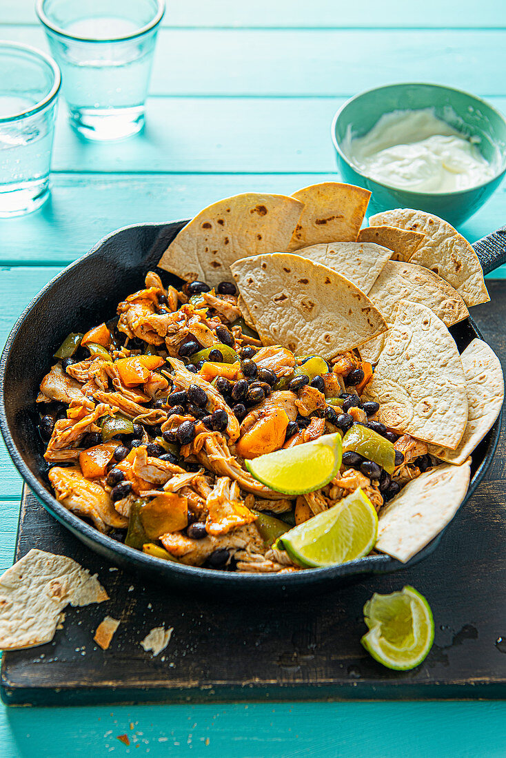 Mexican pulled chicken with peppers, black beans, mexican spices and tortilla chip