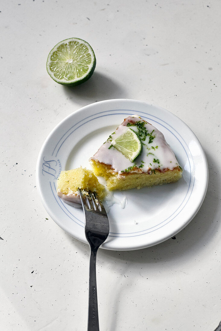 A piece of lime cake with a fork