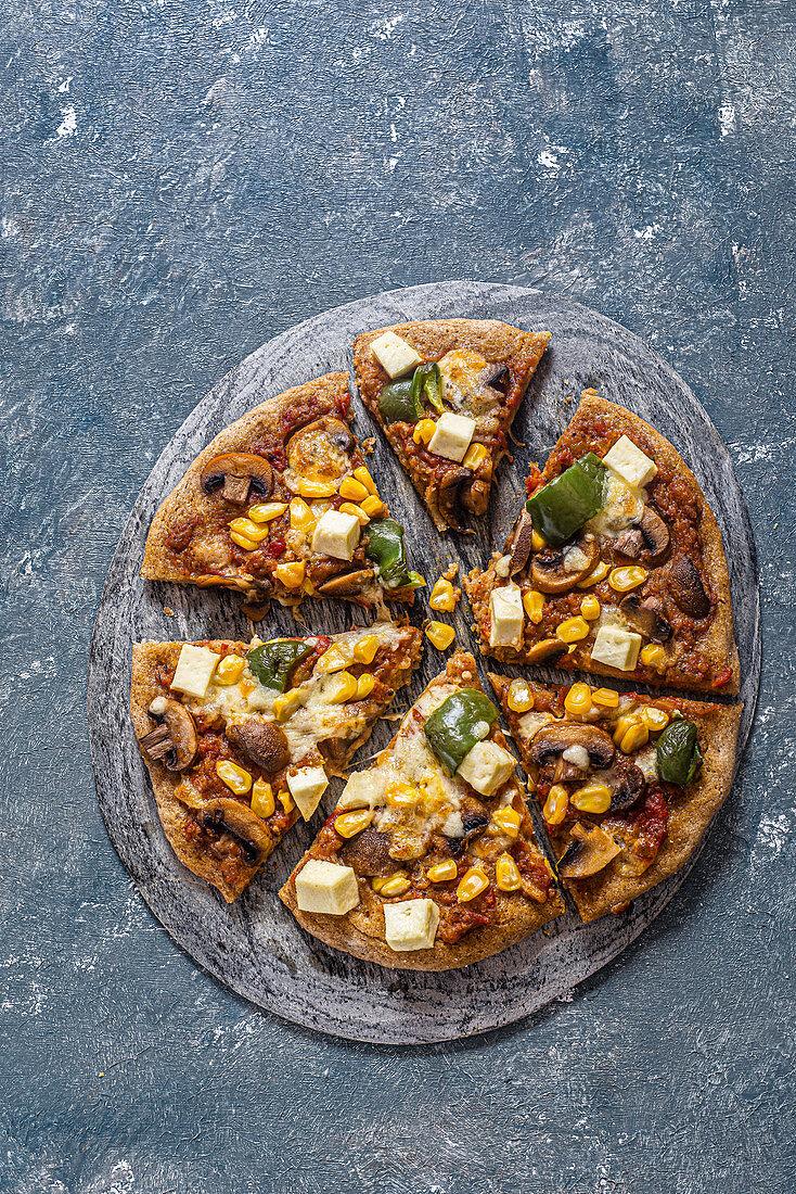 Multi grain swee tcorn and mushroom pizza with paneer