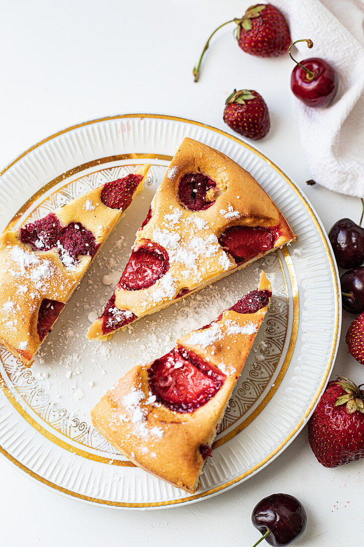 Almond cake with strawberries and cherries