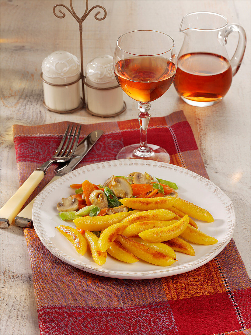 Fried potato noodles with carrot and mushroom vegetables