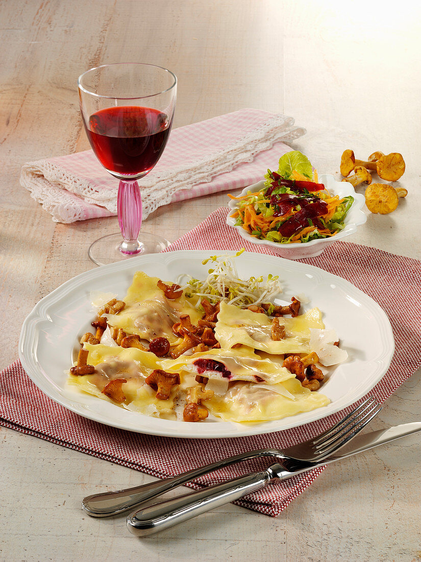 Red filled ravioli with chanterelles and nut butter