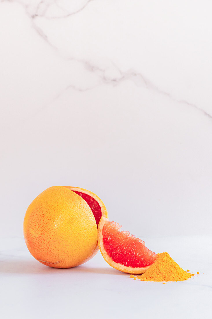 Ruby grapefruit with wedge and grapefruit fruit powder