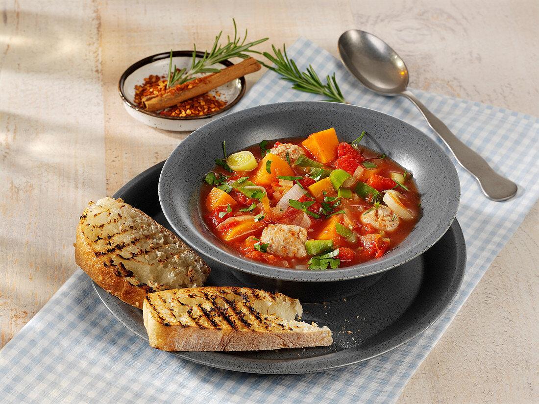Tomato and sweet potato stew with sausage