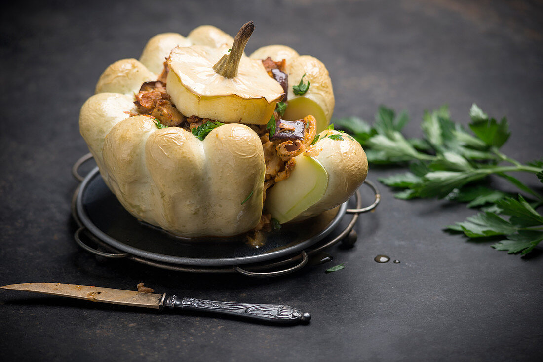 Oven-baked white patisson squash filled with jackfruit and eggplant