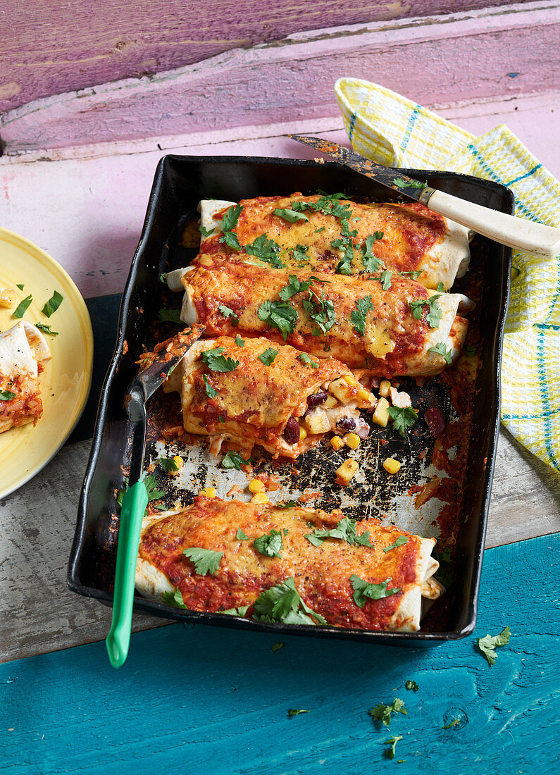 Tex-Mex enchiladas with chicken, corn and beans