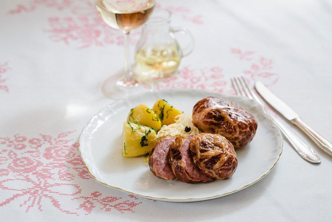 Saumaise (cured meat in a pork net)