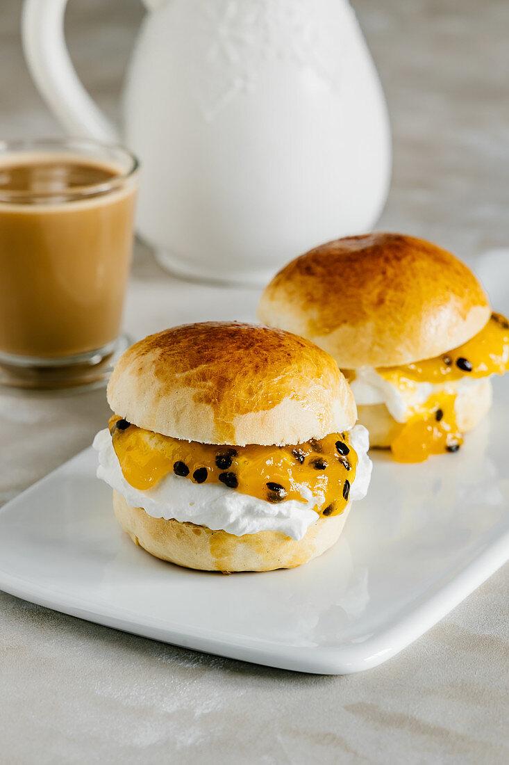 Vanilla buns with fresh whipped cream, mango and passion fruit jam