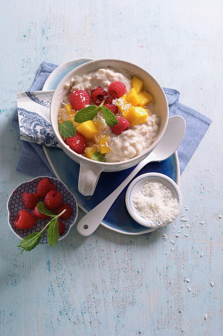 Mango and coconut porridge with raspberries