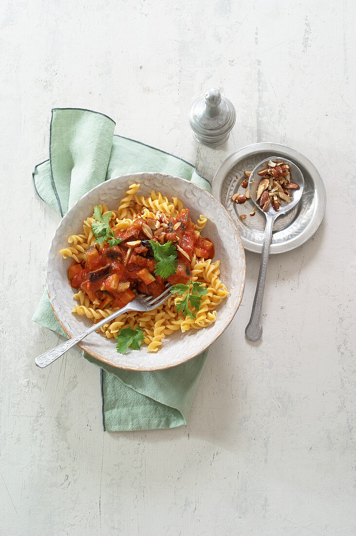 Oriental chickpea pasta with eggplant and smoked almonds