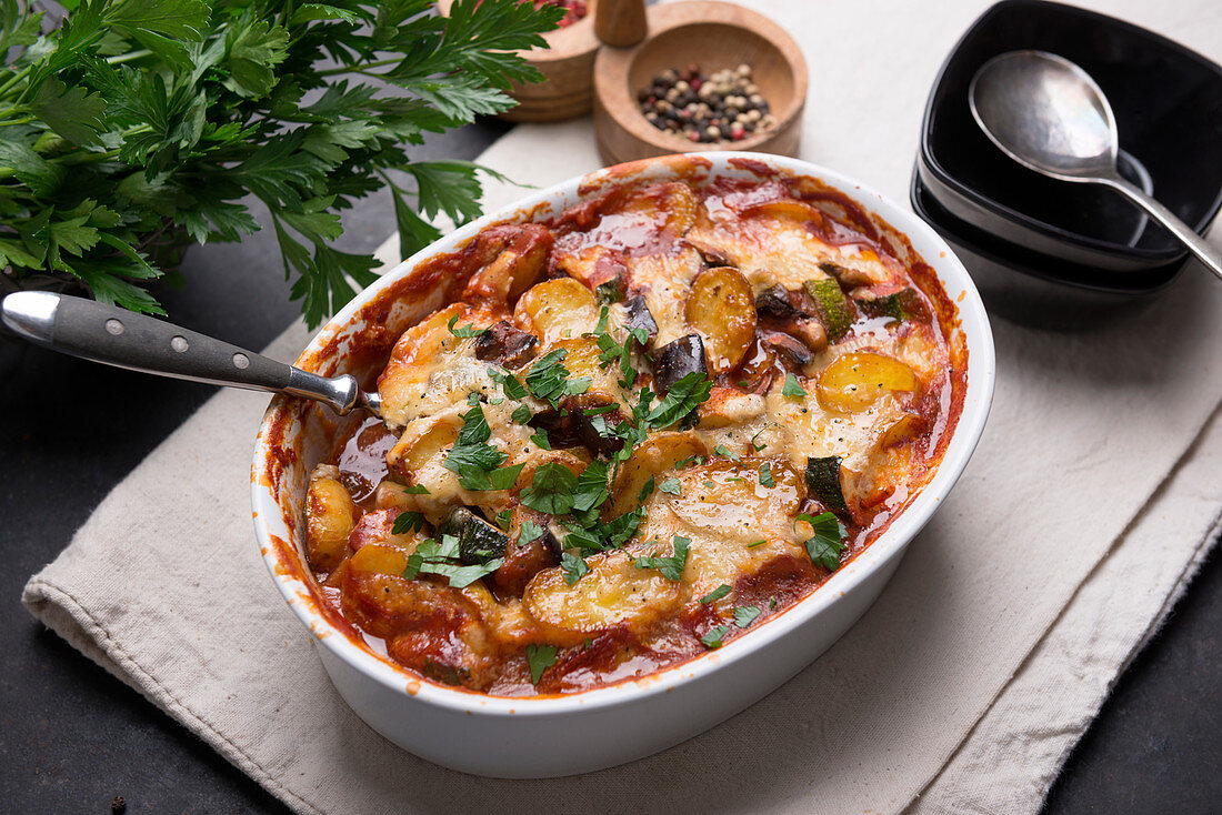 Vegan potato and aubergine and courgette bake