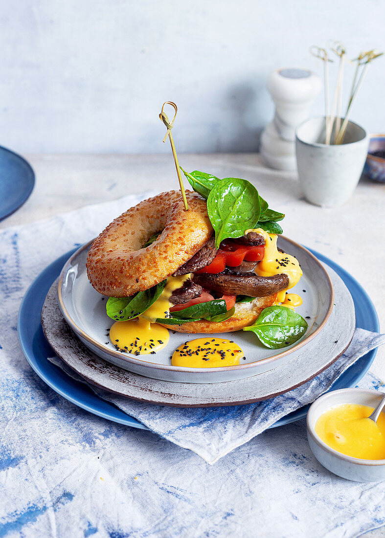 Bagels with steak stripes, Portobello mushrooms and cheese sauce