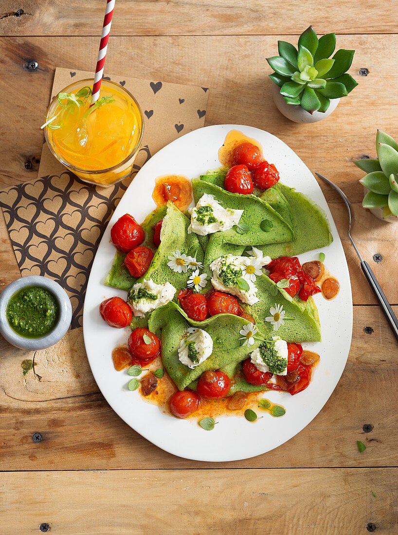 Basil pancakes with cherry tomatoes