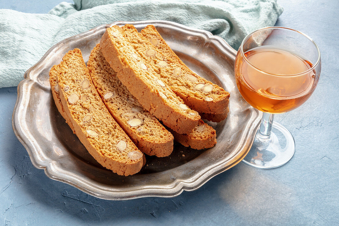 Biscotti, traditional Italian almond biscuits, with a glass of santo sweet wine