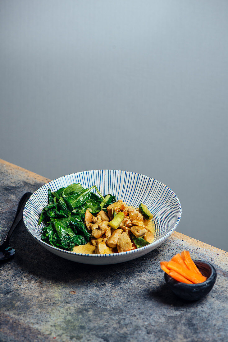 Thai curry coconut chicken with fresh baby spinach