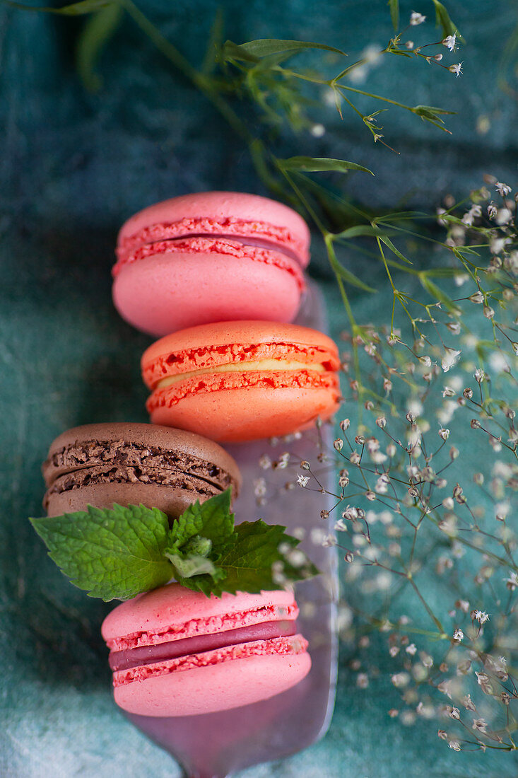 Different colored macarons on a cake server