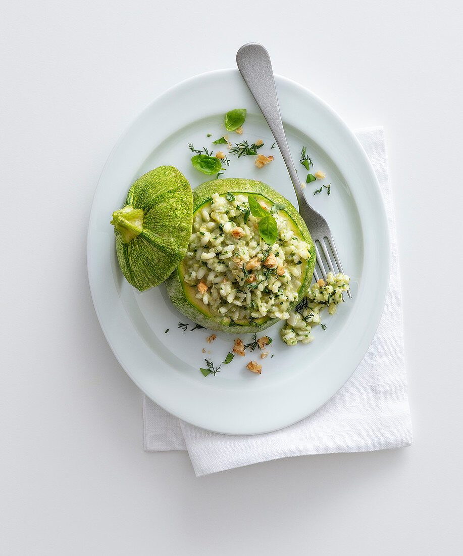 A stuffed, round squash with herb and nut risotto