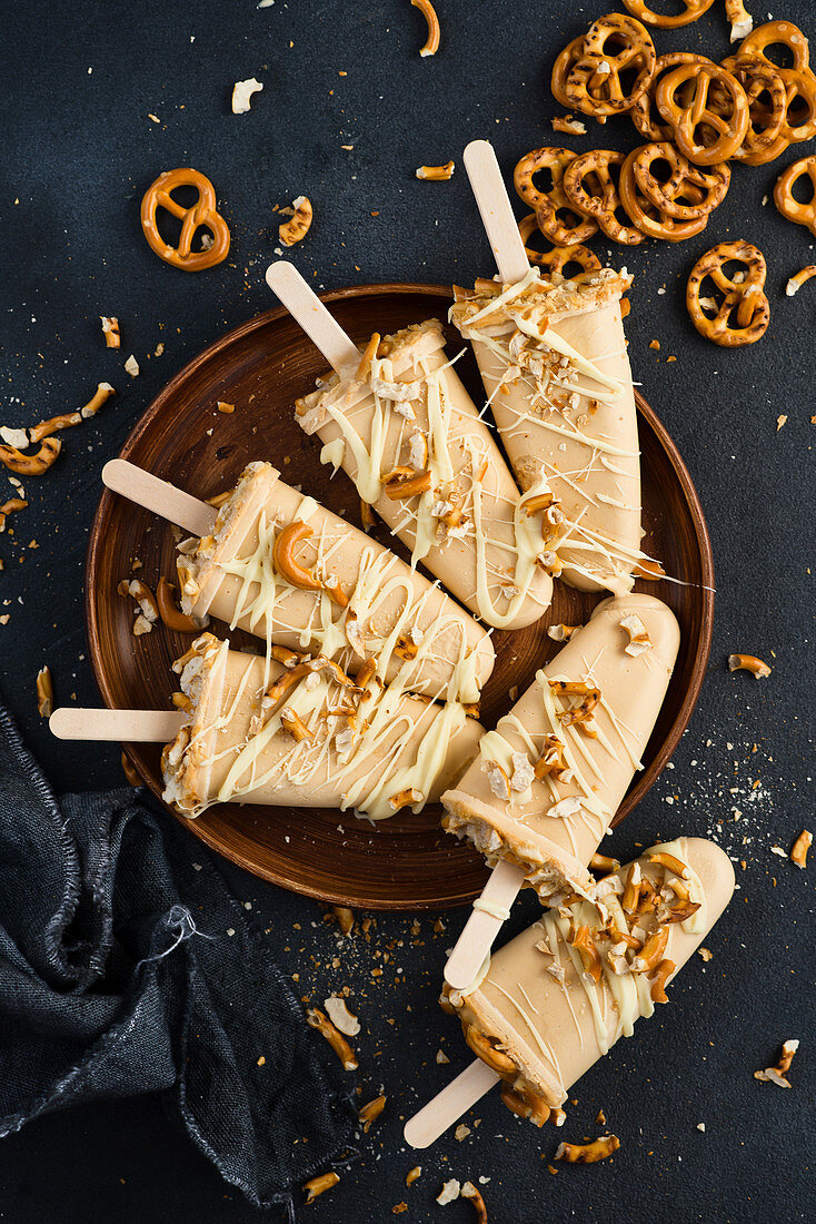 Caramel ice cream on a stick with salty pretzels