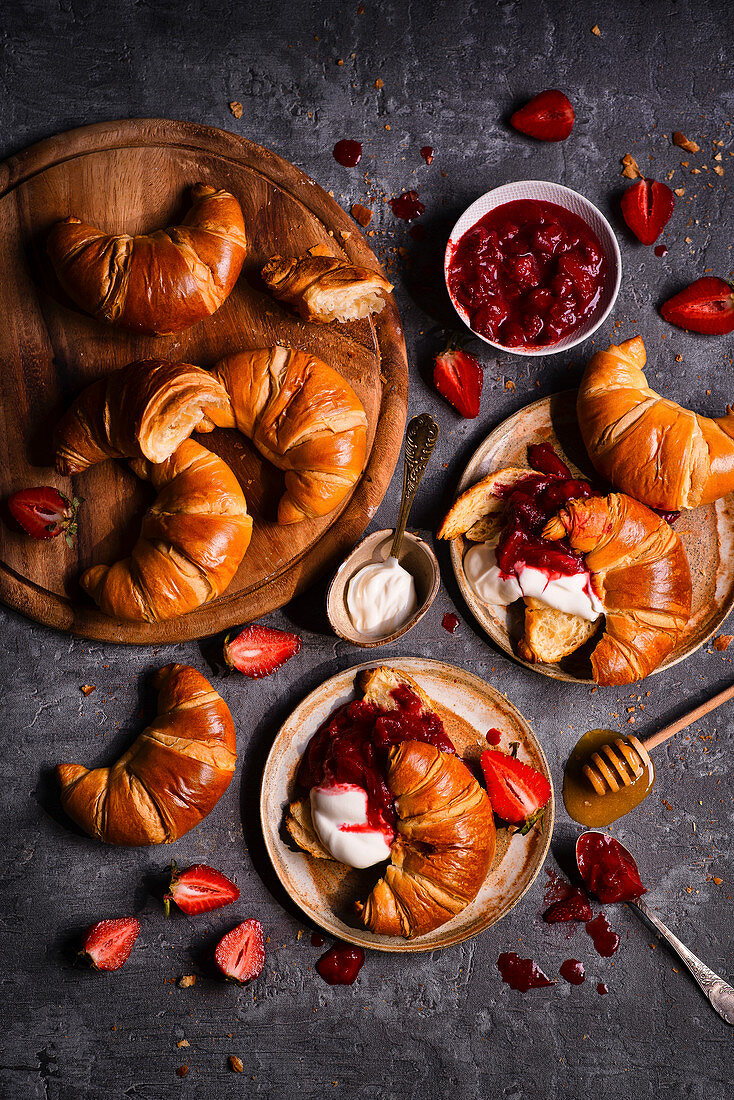 French croissants with yoghurt and strawberry rhubarb jam and honey