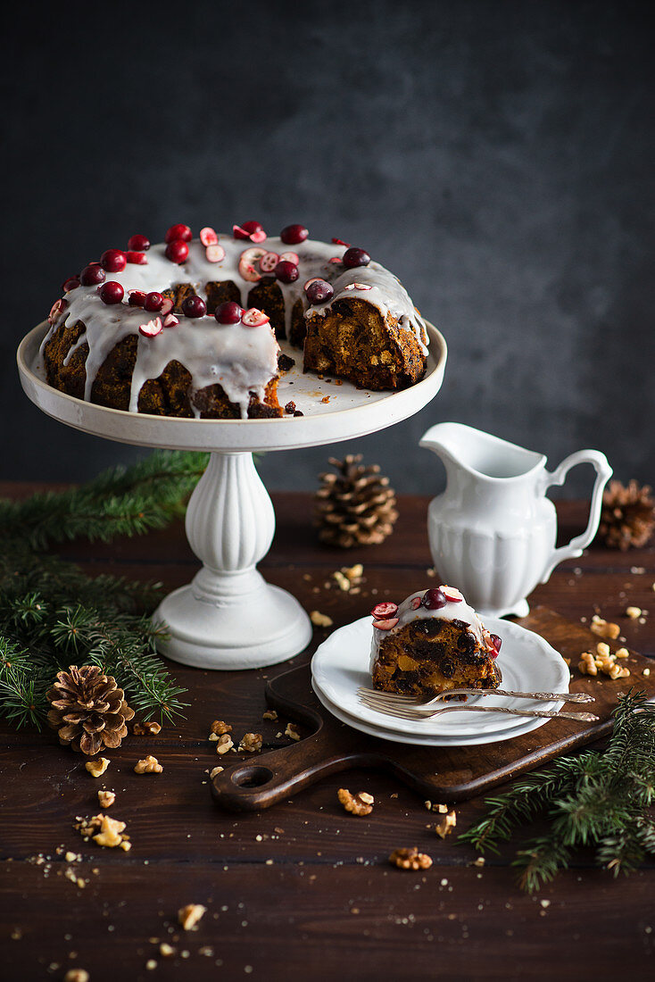 Fruit based Christmas English pudding with topping and cranberries