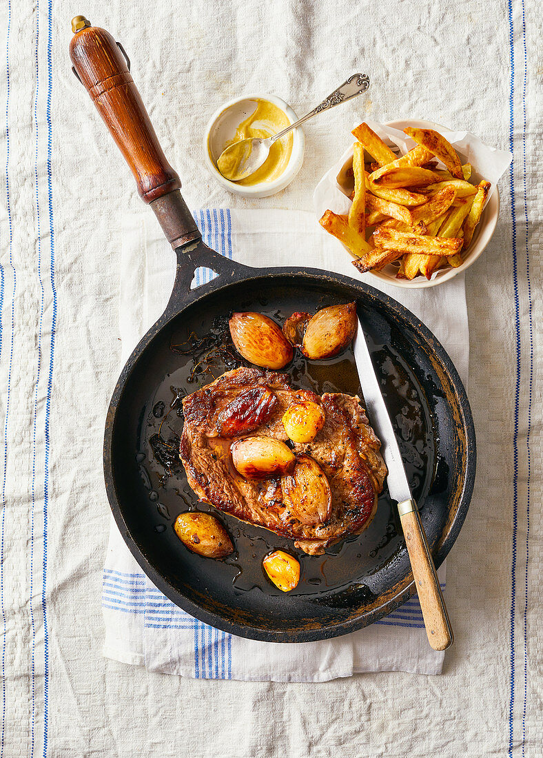 Rib-eye steak with roasted shallots and frites