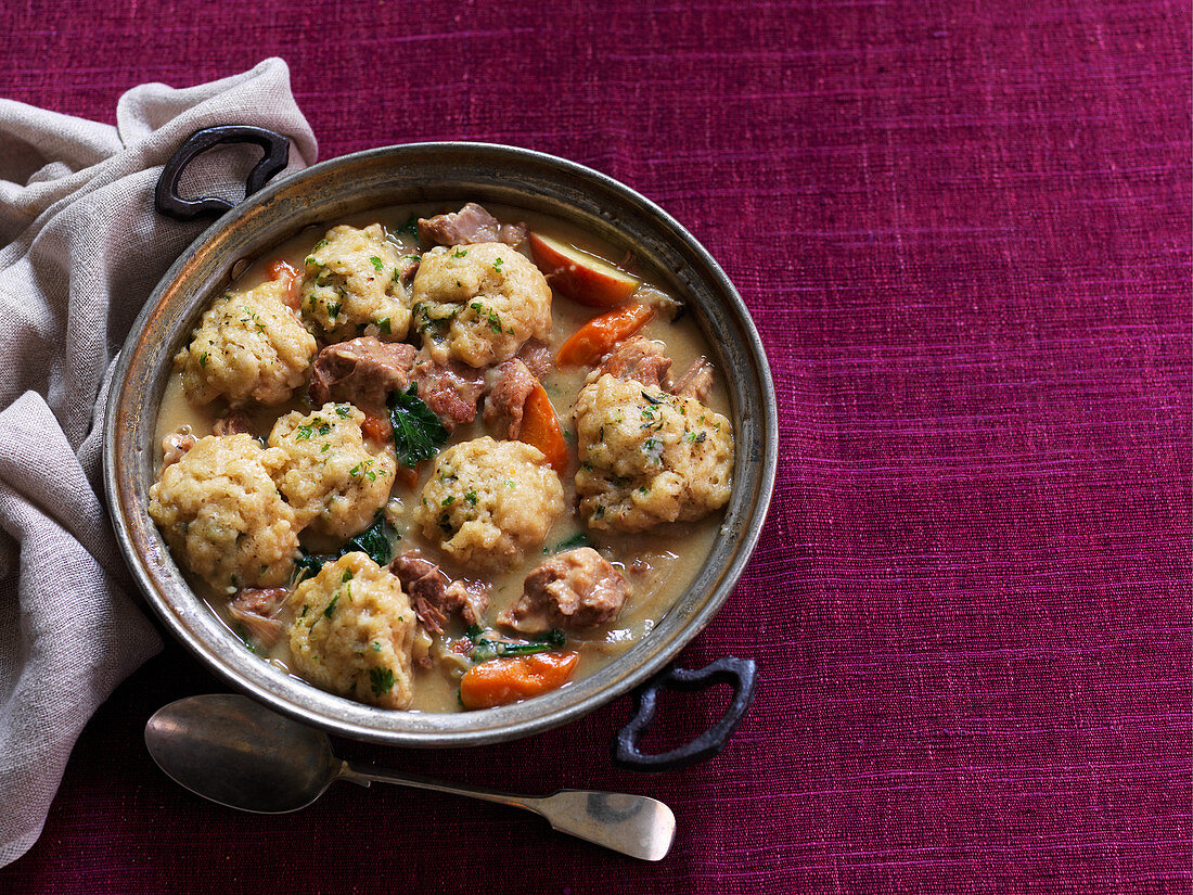 Slow-cooked pork and apple pot stew with thyme dumplings