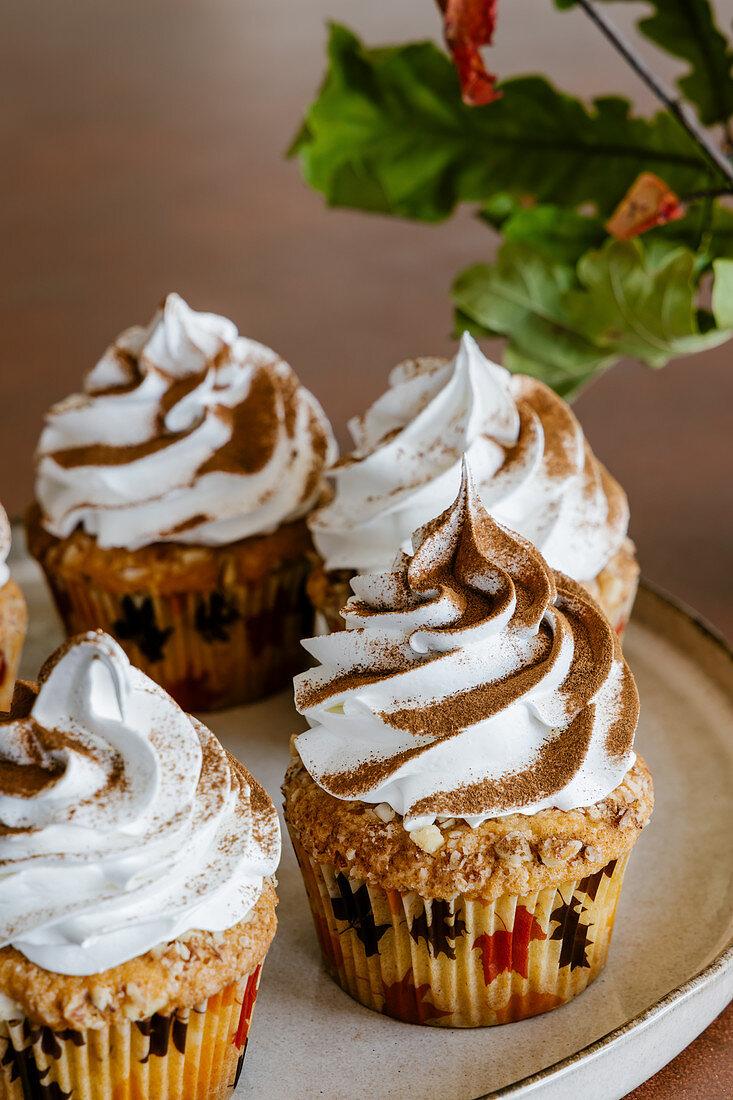 Cinnamon almond cupcakes with swiss meringue cream frosting
