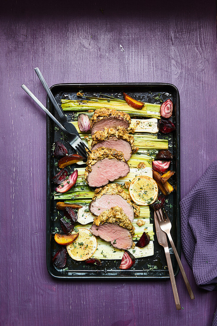Beef fillet with a mustard crust, leek and beets in an orange vinaigrette