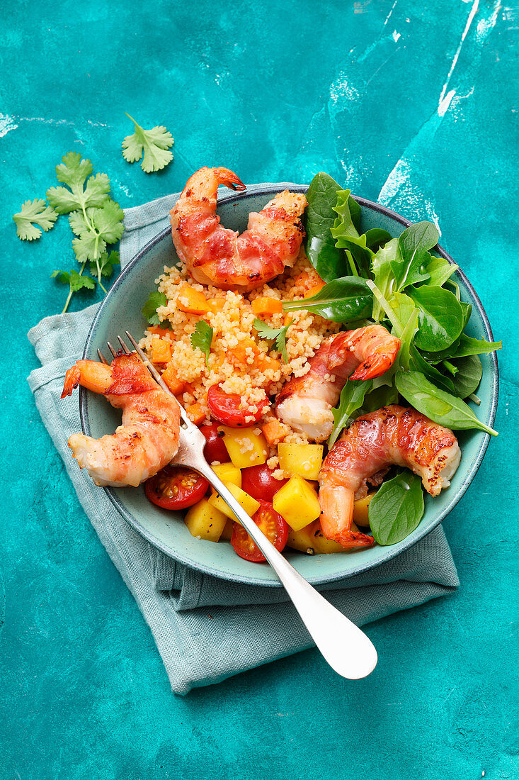 Couscous with bacon prawns